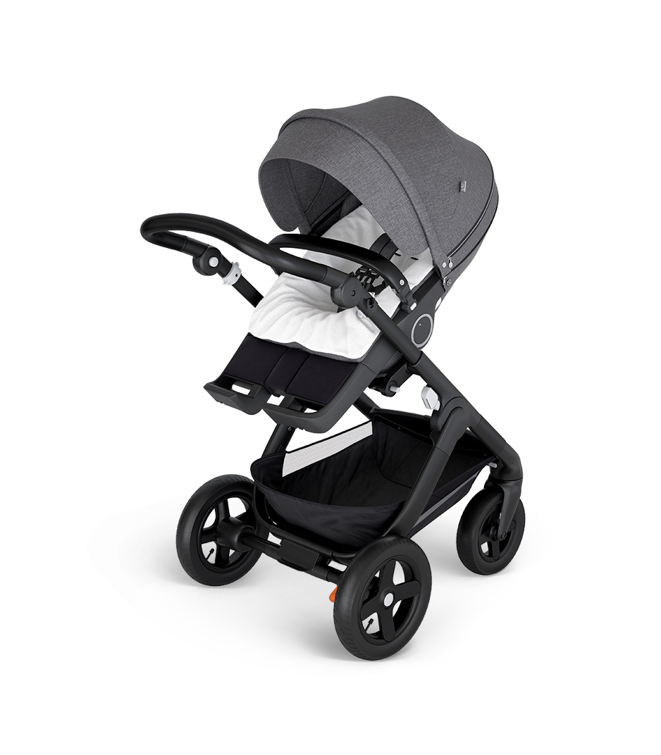 Stokke® Trailz™ with Black Chassis and Stokke® Stroller Seat Black Melange. Stokke® Stroller Terry Cloth Cover.