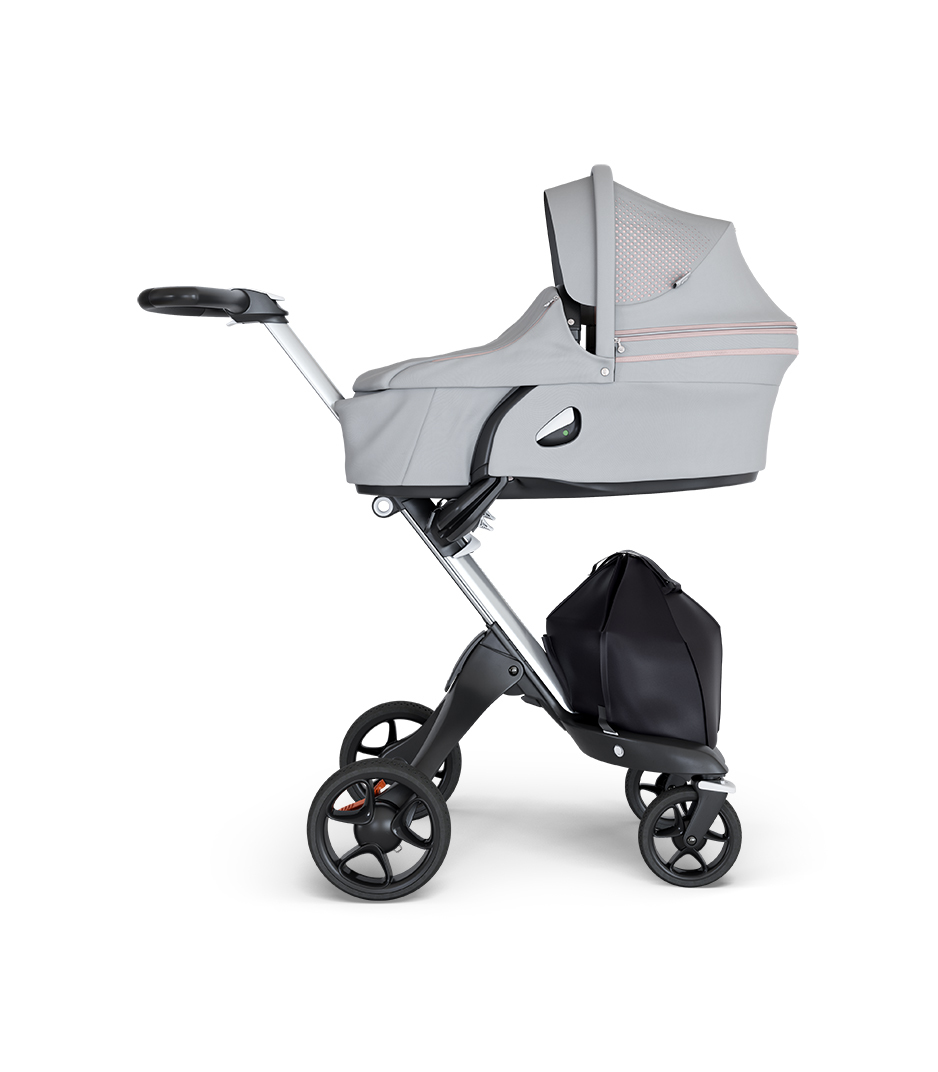 Stokke® Xplory® wtih Silver Chassis and Leatherette Black handle. Stokke® Stroller Carry Cot Athleisure Pink.