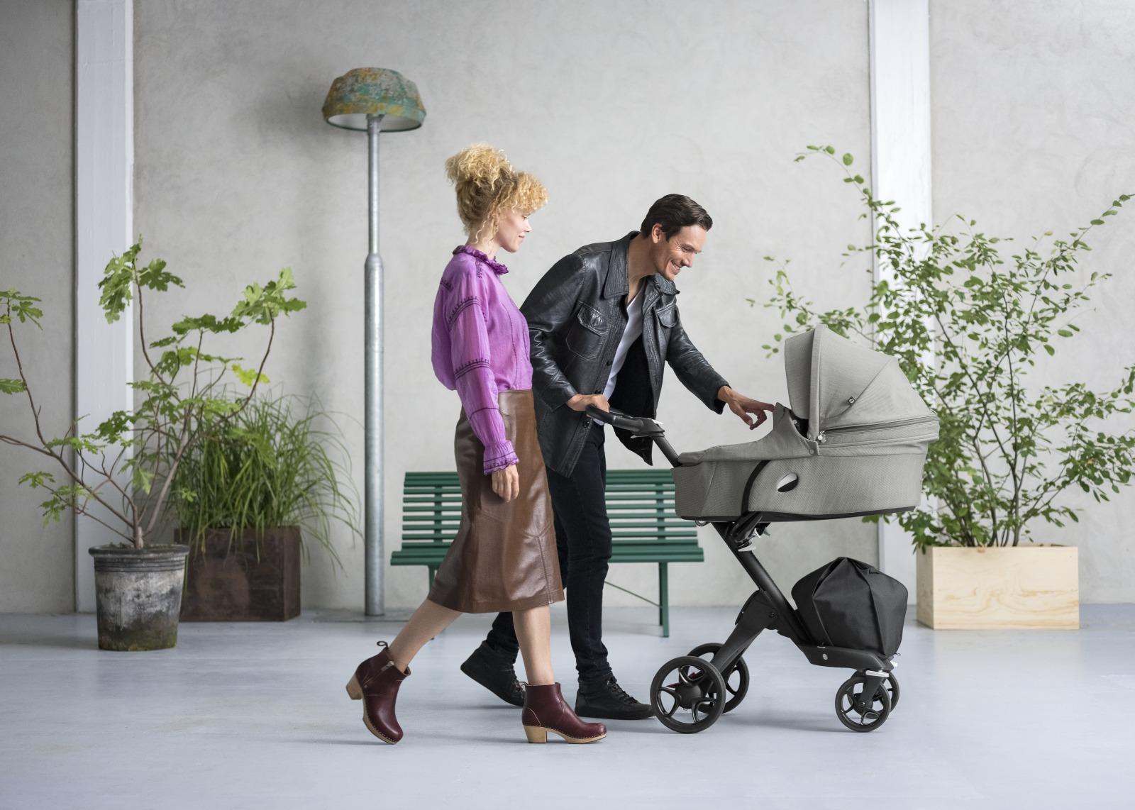 Stokke® Xplory® with Black Chassis and Stokke® Xplory® Carry Cot, Brushed Grey.