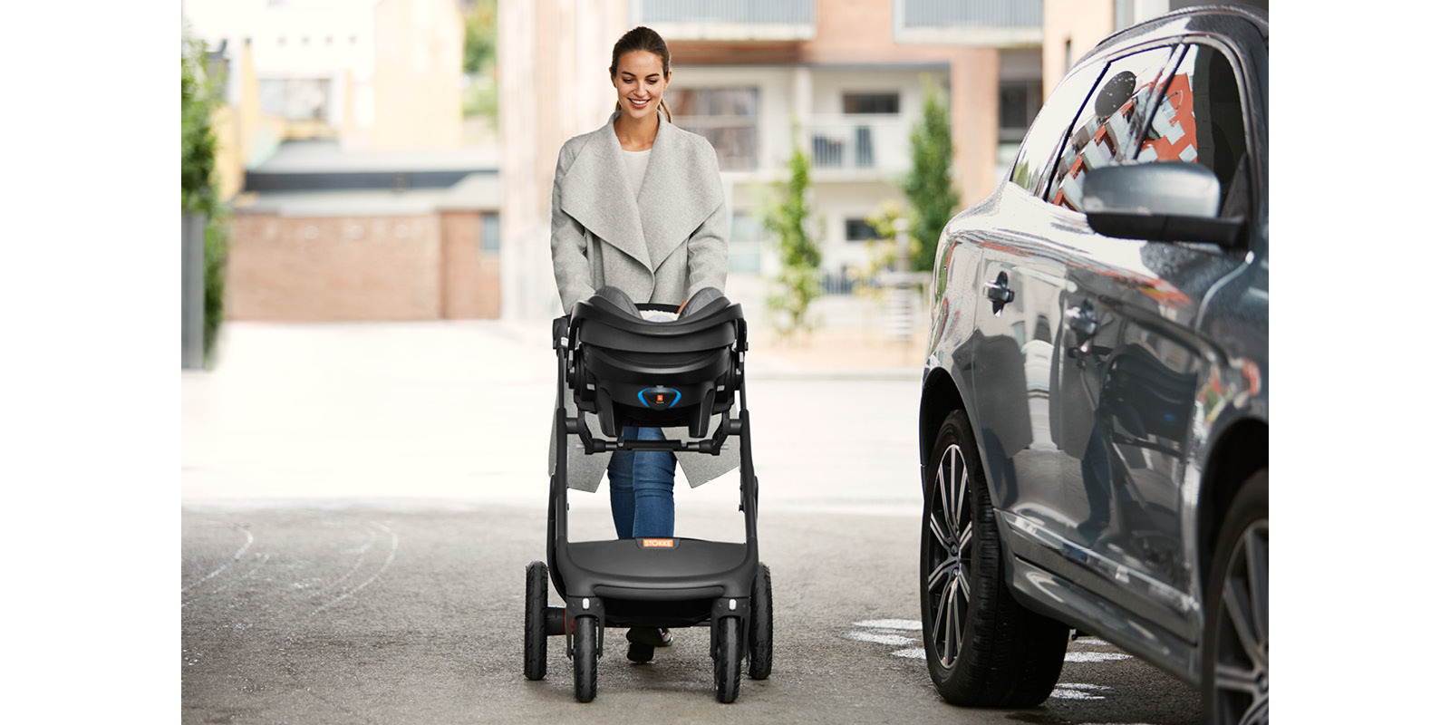 Stokke® iZi Go Modular™ X1 by Besafe®, Black Melange. Mounted on Stokke® Trailz™.