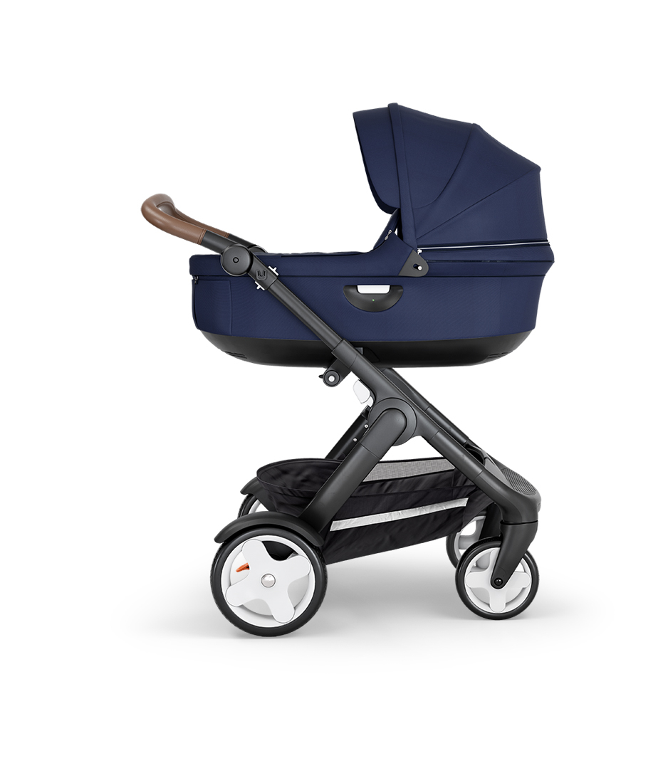 Stokke® Trailz™ with Black Chassis, Brown Leatherette and Classic Wheels. Stokke® Stroller Carry Cot, Deep Blue