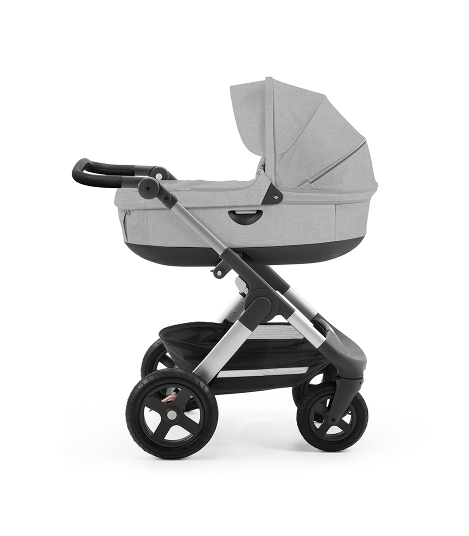 Stokke® Trailz™ with silver chassis  and Stokke® Stroller Carry Cot, Grey Melange. Leatherette Handle.